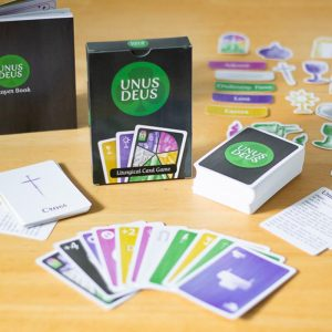 Unus Deus card game with book and stickers